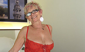 Horny mature slut playing with regard to herself