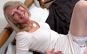 Blonde of age slut playing with her pussy