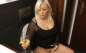 Fat blonde housewife getting wet