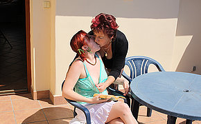 of age lesbian doing a hot babe on rubdown the roof