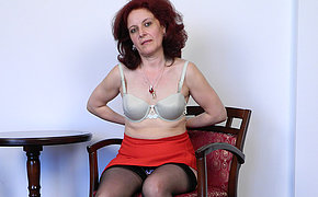 Horny mature battleaxe masturbating in a chair
