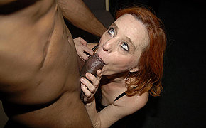Red grown up slut munching on a big black cock