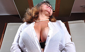 Big breasted mature slut playing with herself