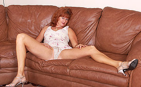 Horny British ma bringing off on her couch