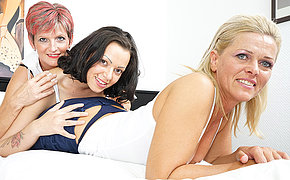 Three old and young lesbians making out on the bed