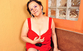 Obese breasted Latin mama playing with her toy