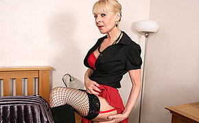 Naughty British mature lady playing with will not hear of dildo