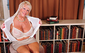 Hot American grandma shows great rack and gets herself wet