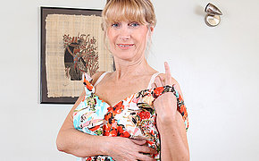 Sexy British housewife shows her goods
