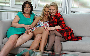 Four aged and young lesbians having a ball vulnerable be passed on couch