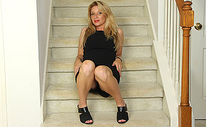 Putrefied American MILF playing with reference to her pussy on the stairs