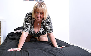 Huge breasted British housewife playing hither herself