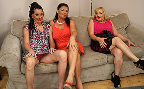 Three horny housewives fooling around on the couch