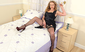 Naughty British MILF playing with herself