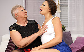 Big Mama having fun with a hot young lesbian babe