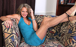 Naughty American MILF effectuation greater than every side herself greater than the couch