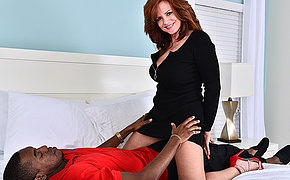 Hot MILF fucking together with sucking a big black cock