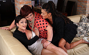 Three mature lesbians getting drenched on the divan