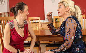 Two mature lesbians playing with their shaved and hairy pussies
