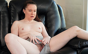 This hairy mom loves to play with her pussy and get wet in her garden