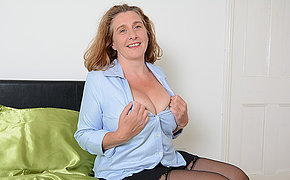 Busty British housewife playing with her tits and pussy