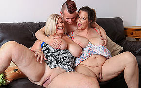 Two busty British housewives share their toyboys cock encircling hot threesome